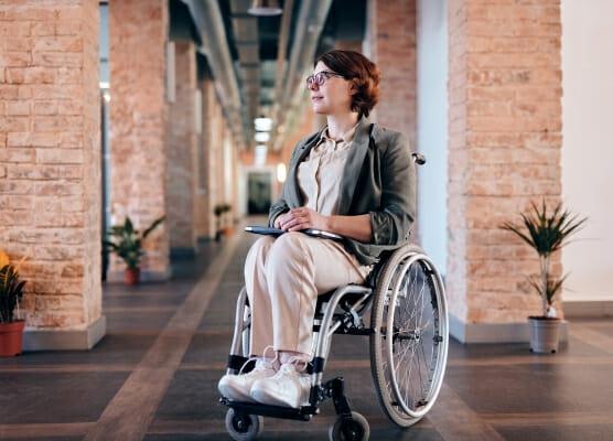 firing on ADA, ADA terminations 556x400 woman in wheelchair